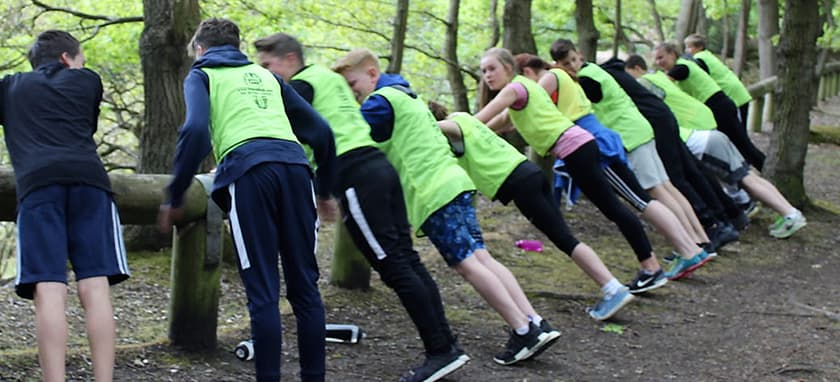 Kids stretching in woods