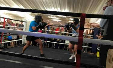 Women boxing in a ring