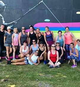 Group of fitness women taking picture