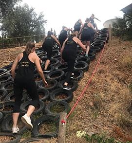 Women climbing tires